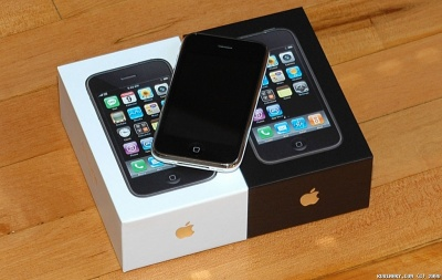 iPhone 3G on top of the boxes.
