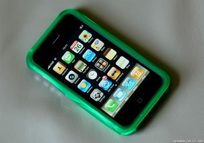 Green case on black iPhone 3G.