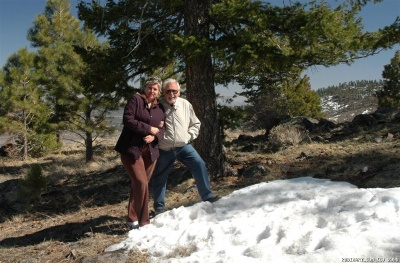 Parents on the peaks of the mountains inside Dixie National Forest.