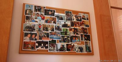 Cork Bulletin Board with Photos of Friends
