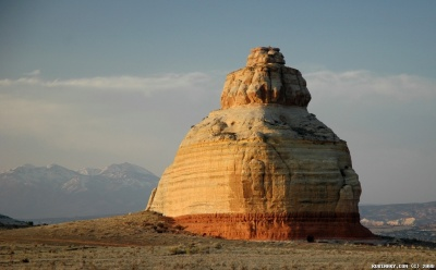 A mountain named Church Rock that we saw on our way to Moab. To gage the size of it look at the cave on the bottom of it. Any car could easily drive into that opening.