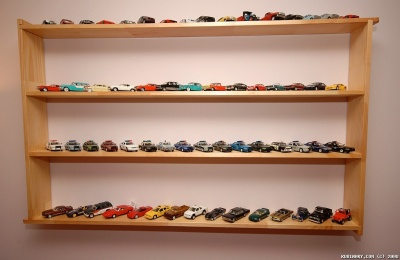 Diecast model cars shelf in our office. Close-up view.