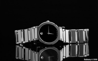 Black and white shot of Movado watch inside the lightbox.
