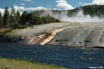 Hot springs coming off Excelsior Geyser into Firehole River.