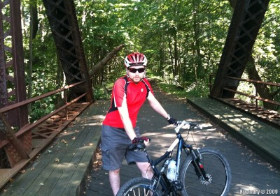 Mountain bike. Some bridge in the middle of the trail.