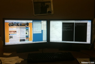 "A pair of 23"" wide-screen Dell monitors."