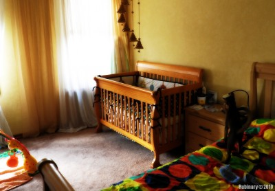 Crib in our bedroom.