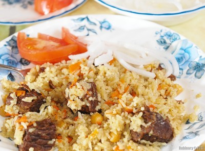 Plov. Some tomatoes and onions in vinegar.