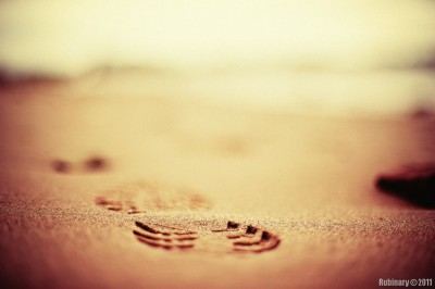 Footprints on the sand. Taken at f/1.2.