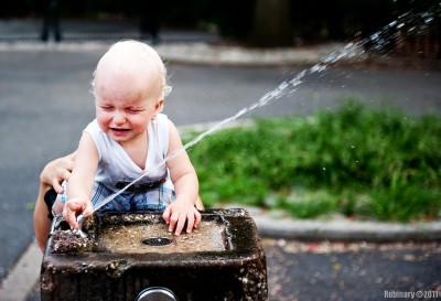 Arosha loves playing with fountain in the park. Sometimes he shoots himself in the face with water and always ends up being covered in water from head to toe.