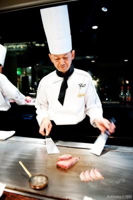 Teppanyaki chef preparing Kobe beef.
