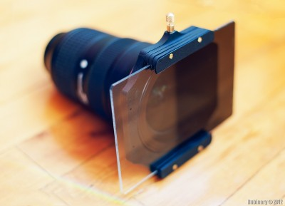 Filter holder with a single filter attached to a lens.