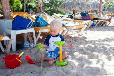 Arosha playing with sand.