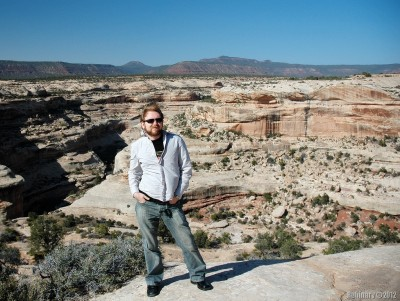 Younger self wearing dress shoes at Natural Bridges National Monument.