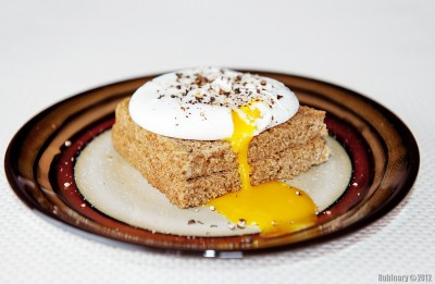 Poached egg on a toast.