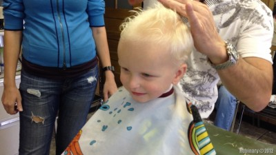 First haircut at barber shop.