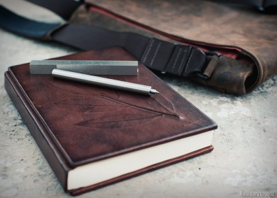 Nice things. Pen Type-A, leather journal with laurel leaf and leather messenger bag.