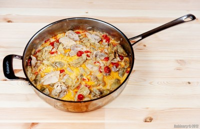 Chicken with artichokes and tomatoes in creamy sauce.