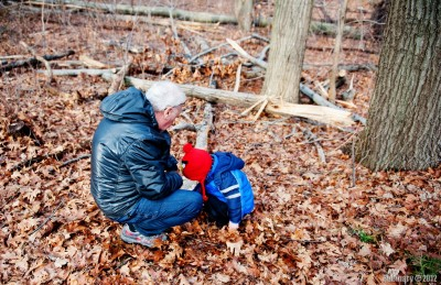 Arosha and grandpa looking at mushrooms.
