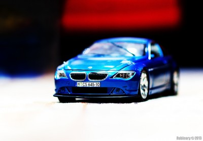 Arosha's BMW. Taken at f/1.4 with +6 AF tune and focus point on the plate.