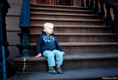 In front of a brownstone.
