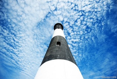 Lighthouse against some funky clouds.