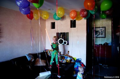 Birthday balloons and a lightsaber.