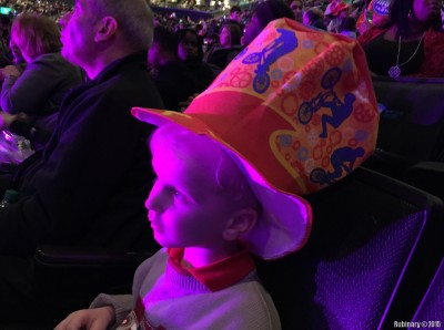 Arosha in big circus hat gifted to him by his seat neighbor.