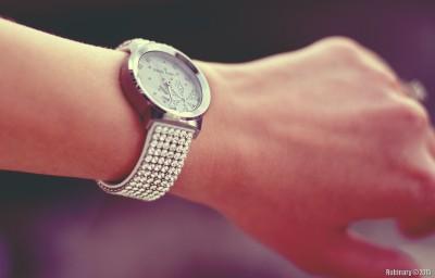 On Alёna's wrist.