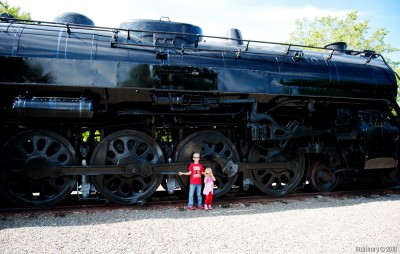 Kids by an old steam engine.