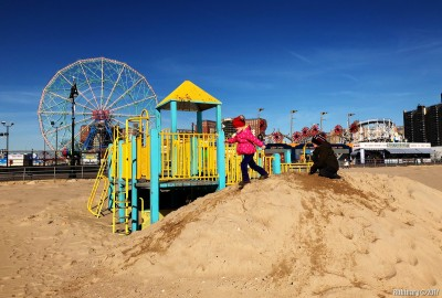 Coney Island. Playing in the sand.