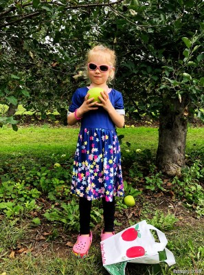 Anna and a huge apple.