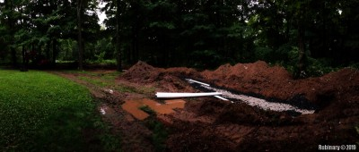 The installation of a new septic system has commenced in the first few weeks after the move. Our poor backyard is being completely destroyed.