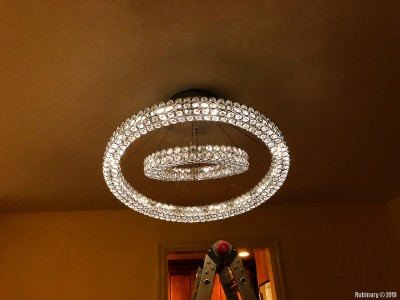 A new and expensive dining room chandelier. Also a huge upgrade over the previous monstrosity. And we kept hitting our heads on the old one. So we put this one closer to the ceiling. It was even harder to install this one because of its massive weight.