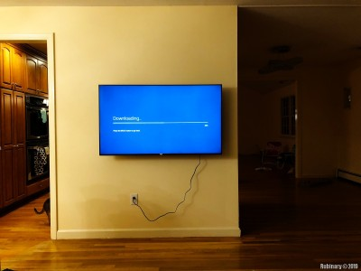 A brand new SONY XBR-55X900F 55 inch TV mounted on the wall in our family room. At first I was trying to hire somebody to put these up. But then I ended up doing it myself. It's not nearly as hard as it seems. A good bracket from Amazon and some tools along with a good stud finder. A cable is still visible on this picture. We're going to fix that.