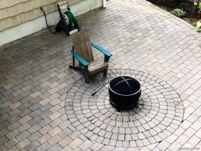 Our patio is starting to take form. Unrestored chair and a new fire pit.