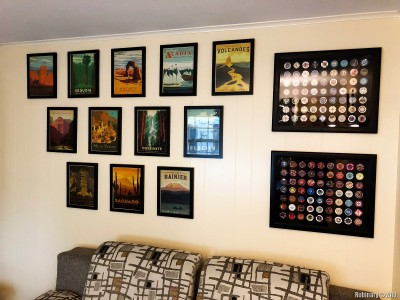 This is a draft of the office back wall. I had a book full of National Park posters for years, but never got around to ordering frames and putting them up on the wall. We picked out some of the best looking ones from some of the parks we've been to. But I hated the wall color of the office. It was so boring.