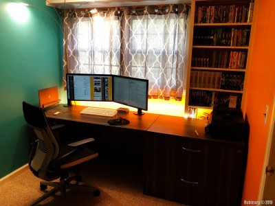 This is the other side of the office and my setup. I took this chance and attached a color Hue LED strip that I had laying around behind the desk. And I finally broke down and bought myself Steelcase Gesture chair. And the shelf in the corners serves as home for our relic collection of DVDs.