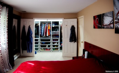 And the final version of our closet. Came out really functional and good looking. Since this picture was taken we've replaced the bedding set, but there are no pictures of that yet.