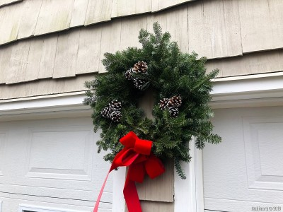 We donated some money to a local boy scout group and they in turn sent us this wreath. We put a hook into the wall between our garages and put the wreath up for the duration of the winter.