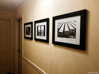 I brought some of my prints I had in the office at work. They are not cheap to make, but I never had a place to hang them at home. Now our hallway seemed like a perfect place.