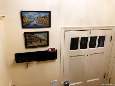 We added a small mail and key shelf by the entrance door. And we added some shoe shelves inside the closet by the same door. And the paintings that are pictured here we've already replaced with a different one.