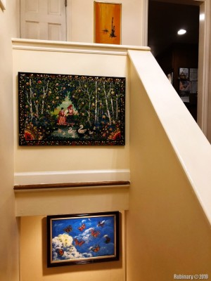 And when you enter the house you see these. Although we've already replaced the bottom one. The one above the stairs we're keeping. It has this Russian feel to it that it seems appropriate. Plus it's very lright, in case it falls down.