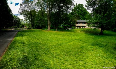 Front yard with freshly cut grass.