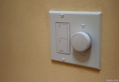 Lutron Aurora switch next to a standard Lutron Caseta smart switch.
