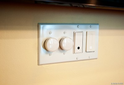 A pair of Lutron Aurora switches next to Wemo smart switches.